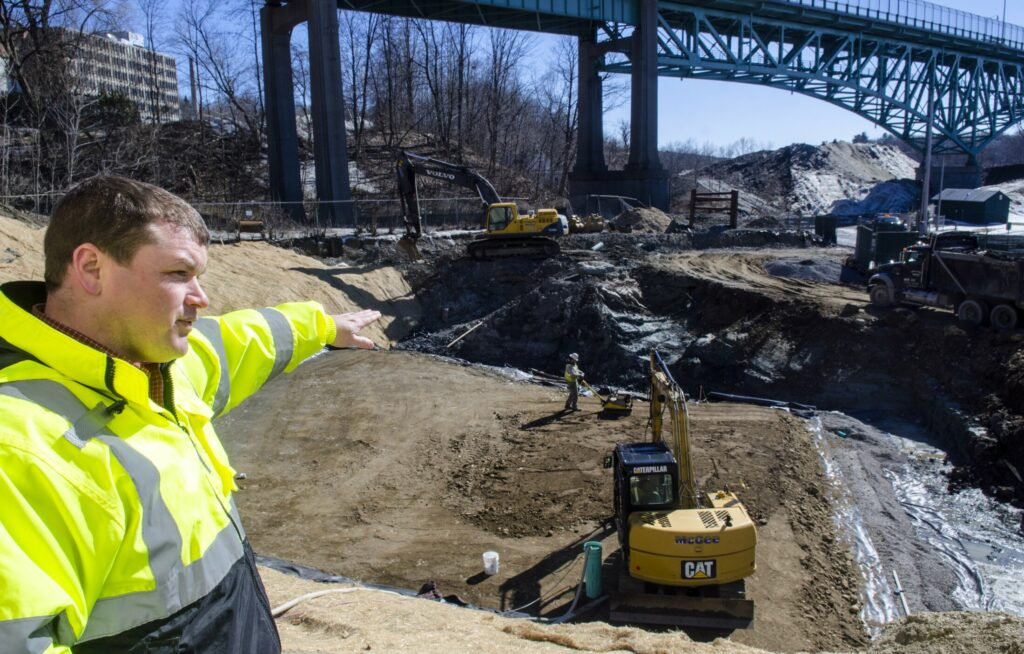 Andrew Begin, assistant general manager of the Greater Augusta Utilities District, talks about construction of a 1-million-gallon storage tank Tuesday on the east side of Kennebec River in Augusta.