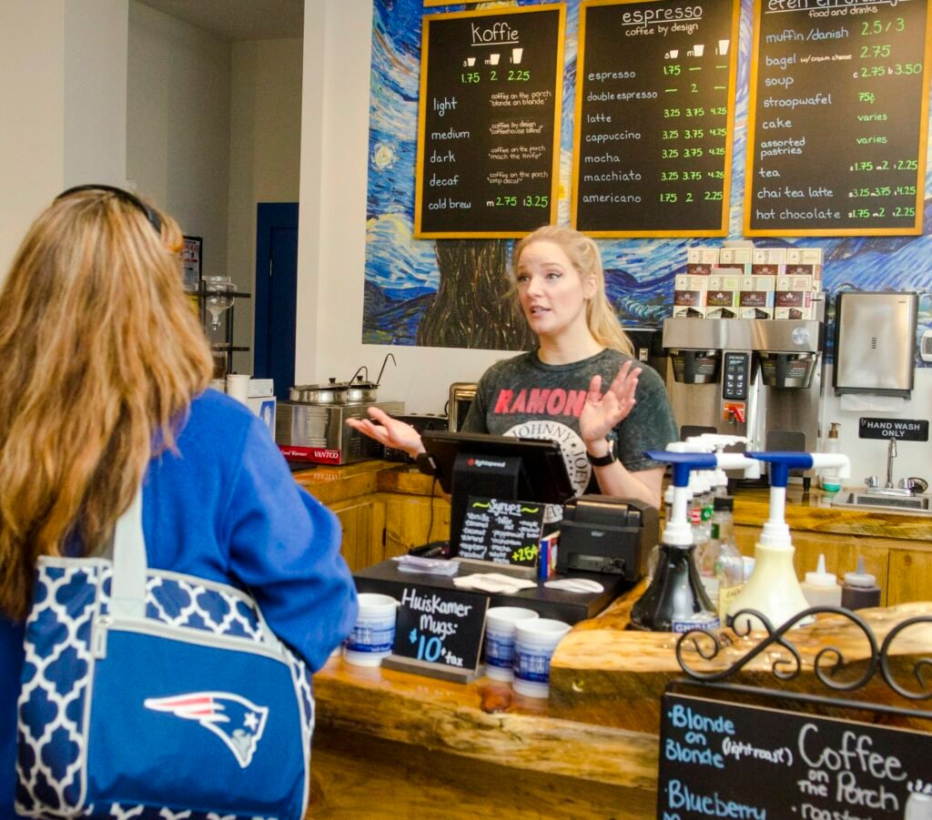 Grace Fectueau waits on customers on Friday at Huiskamer coffee shop in downtown Augusta.