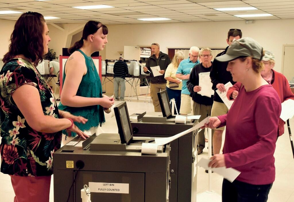 Winslow resident Michelle Dugal casts her ballot at the VFW on June 11 in the $8.1 million bond referendum to renovate the elementary and high schools and close the junior high. Rising construction costs have pushed the cost of renovations beyond the $8.1 million voters narrowly approved.