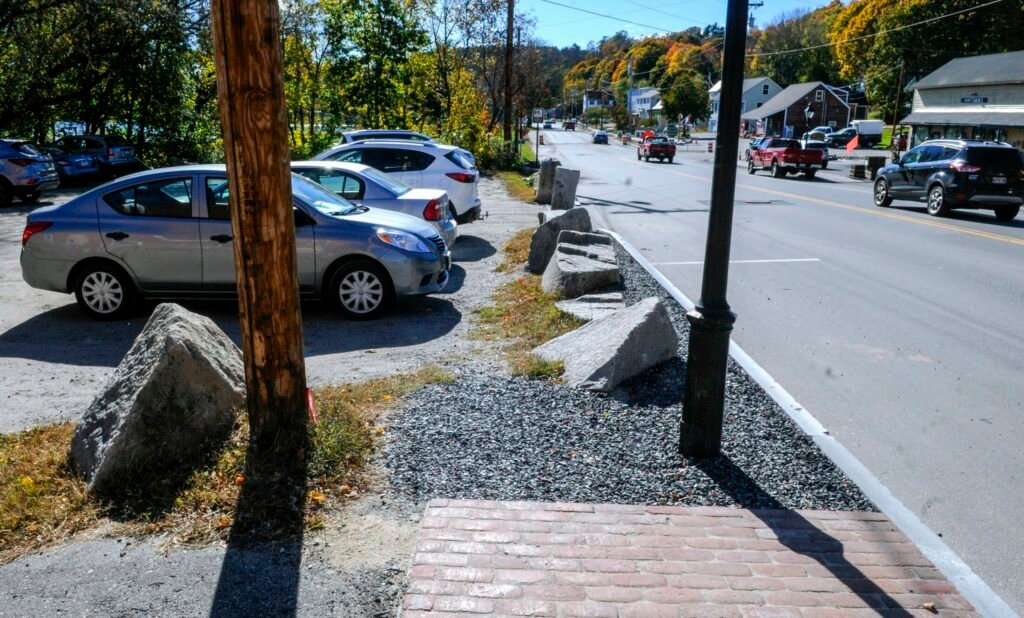The new sidewalk ends at the boulders by the Lucky Garden restaurant parking lot, seen October 22, on Water Street in downtown Hallowell.