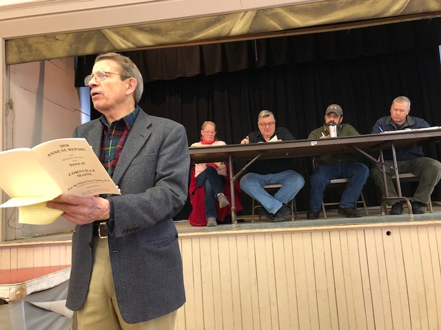 Peter Mills moderates Cornville's Town Meeting on Saturday at the Town Hall. A Cornville resident, Mills also is executive director of the Maine Turnpike Authority. Behind him, from left, are town Clerk Tammy Chamberland, Board of Selectmen Chairman Mel Blaisdell and selectmen Michael Gould and Rick Oberg.