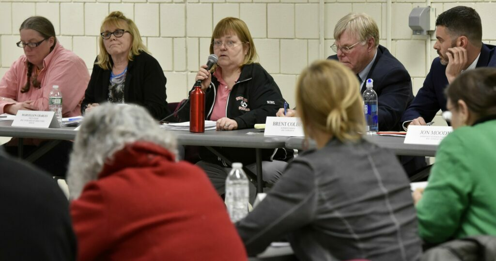 SKOWHEGAN,  ME-  MARCH 7:  SAD 54 school board chair Dixie Ring, center, moderated a meeting where the school board voted to cease using word 'Indian' in district schools during a meeting March 7 in Skowhegan.