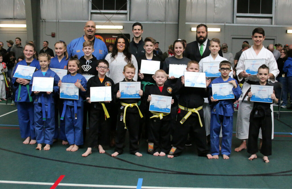 Members from Huard's Martial Arts in Winslow participated March 23 during the 39th Battle of Maine Martial Arts Championships at Thomas College In Waterville. They helped raise close to $5,000 for the Children's Miracle Network. In front, from left, are Mikayla Achorn, Lucia Lacroix, Ayden Karstens, Keegan Miranda, Quincy Schneider, Preston Schneider, Logan Dow and Jaden Tavares.   In back, from left, are Carlie Bertrand, Abby Dudley, Mason Bumba, Event Promoter Mark Huard, Philanthropy Officer Nicole Trainor, Waterville Mayor Nick Isgro, Luke Raven, Olivia Rando, H & R Block Owner Cory Dow, Nicolas Thibault and Pedro Natario.