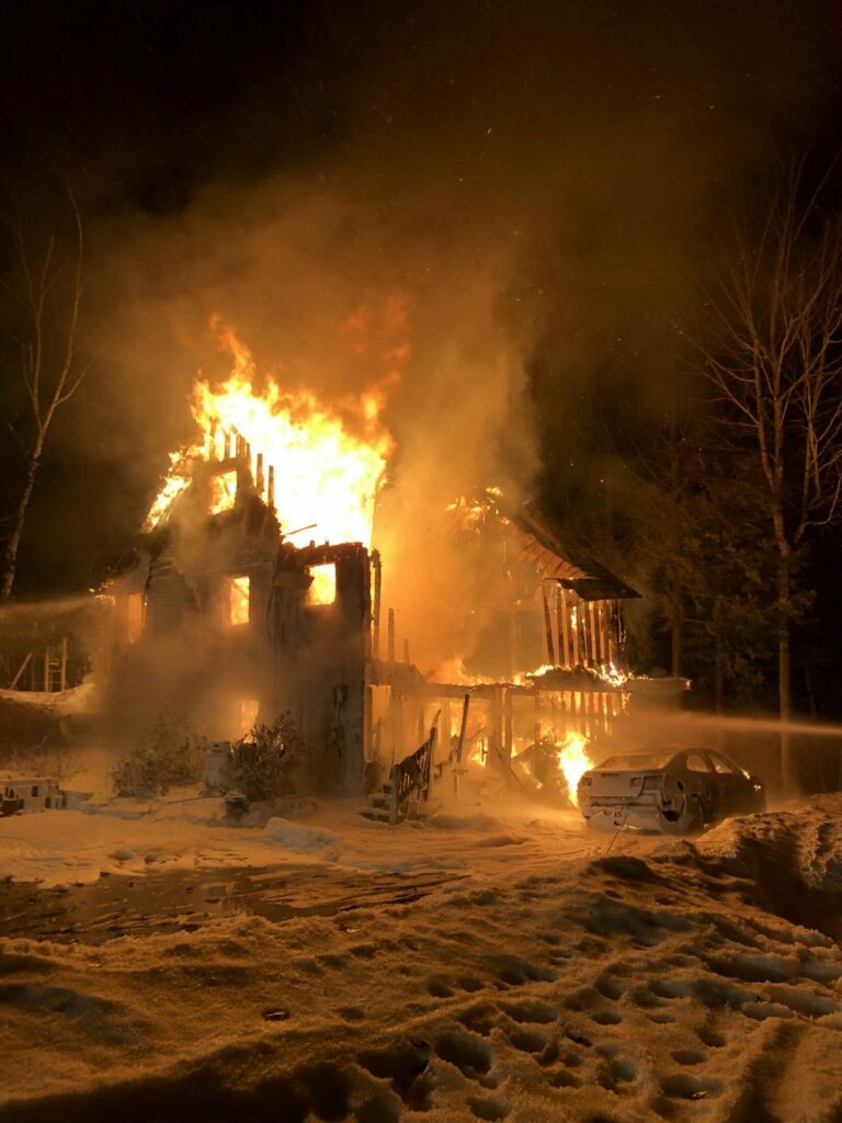 A house at 193 Boot Cove Lane in Winthrop burns early Saturday morning. No people were hurt in the fire, but a dog and cat perished, according to Winthrop Deputy Fire Chief Mark Arsenault.