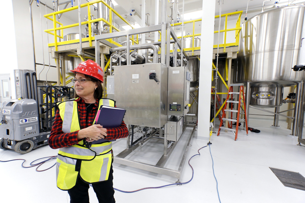 Betsy Williams, vice president of manufacturing operations at ImmuCell, gives a tour of its facility on Evergreen Drive in Portland in 2017.