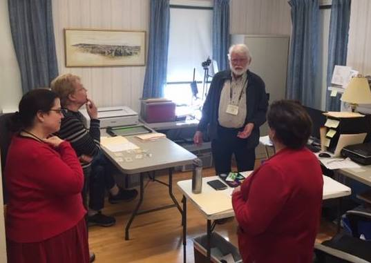 Ernest Plummer talks with volunteers during the Feb. 14 volunteer social at Kennebec Historical Society in Augusta.