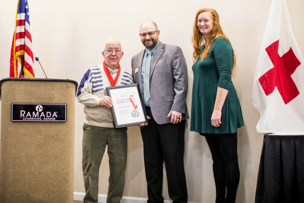 Jack Schrader,  left, recipient of the Blood Services Award,  with Johnny Blanton, Red Cross Biomedical Services District Manager, and Veronica Dumais, honorary event chairwoman of the Real Heroes Awards Breakfast of the Central and Mid Coast Maine Chapter of the American Red Cross.