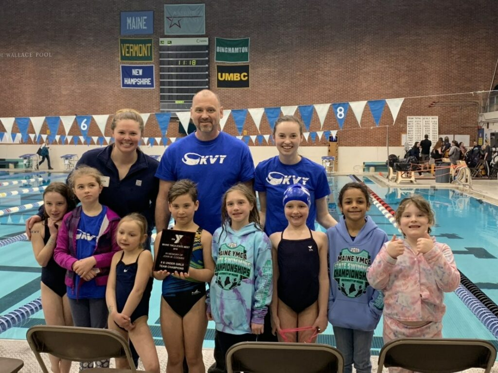 The 8 and Younger Girls  Team Champions, front from left, are Meghan Inch, Sara Fournier, Alice Lazure, Anya Johnderson, Sophia Wilcott, Gaby Lazure, Millie Story and Gudrun Ziemer. Back from left are Head Coach Sara Knight, Coach Mike Schmidt and Assistant Coach Victoria Weber.