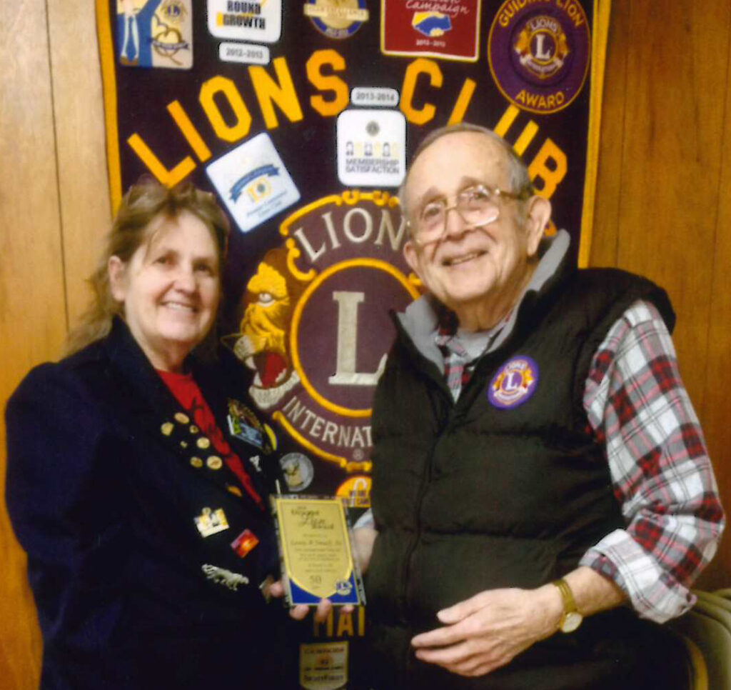Second Vice District Governor and Club President Bunny Parks, PDG, left, with Gardiner/Augusta Lions Club Past International Director Lewis Small Sr. Small recently was honored for 50 years of Lions service.