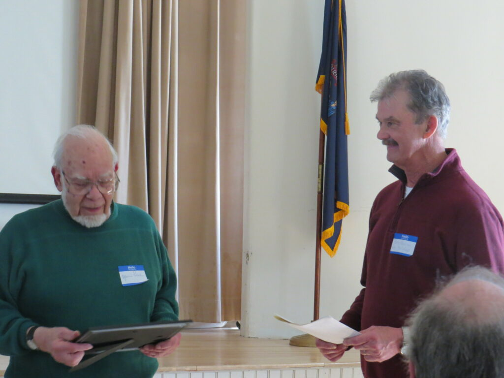 Marius Péladeau, left, of Readfield, was honored at the Readfield Historical Society's annual meeting on March 16, for decades of preserving Maine history. Bob Harris, RHS president, presented the award.