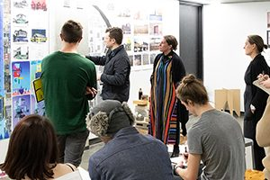 Nikole Bouchard (center, in stripes) works with students in a studio class at the University of Wisconsin-Milwaukee.