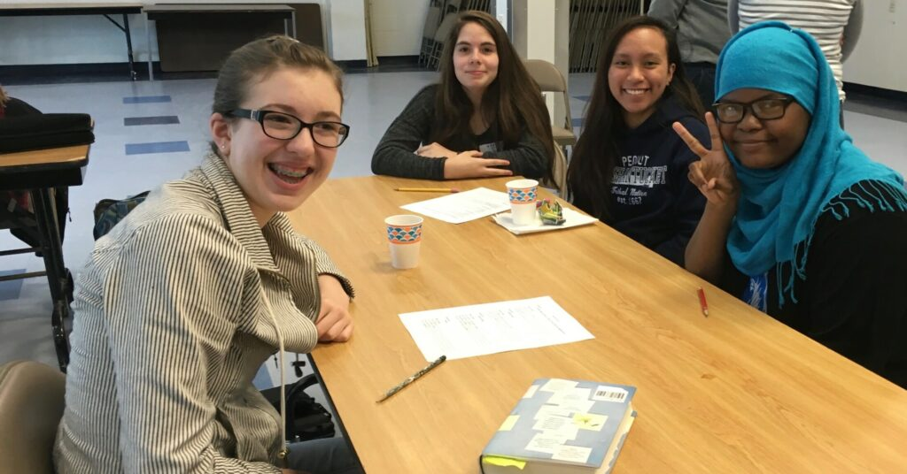 Anna Swimm, Samantha Cloutier, Rizzajem Reboquis and Fatumo Sidow bond over their poems during an Operation Breaking Stereotypes meeting during their first year together.