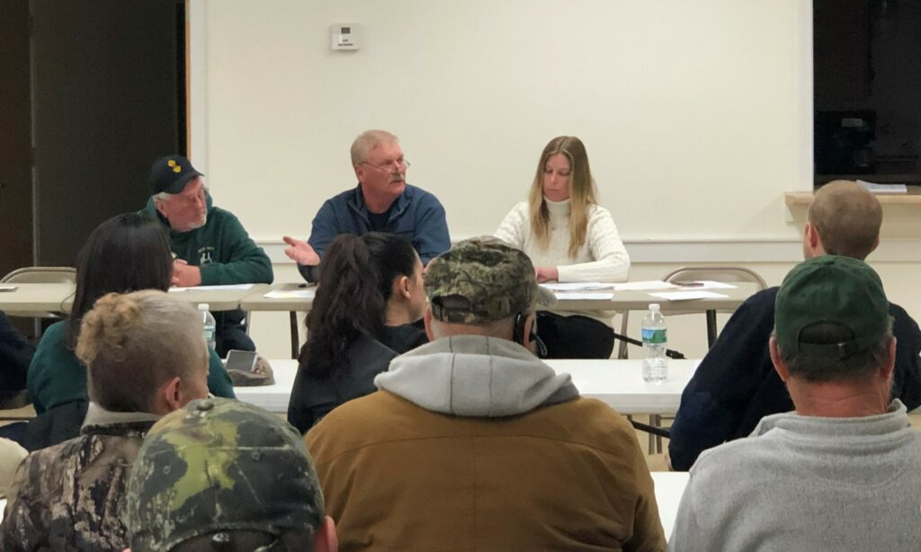 Thorndike Selectman Bob Carter, center, addresses volunteer firefighters moments before they resigned en masse at a Feb. 20 meeting.
