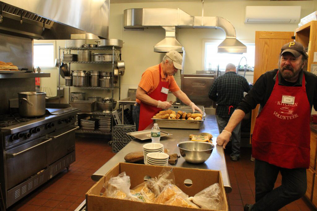 Volunteers at the Midcoast Hunger Prevention Program soup kitchen prepare lunch on Wednesday. The kitchen has experienced a 50,000 meal-per-year increase over the last two years, and in January and February, the food bank experienced its busiest two months ever.