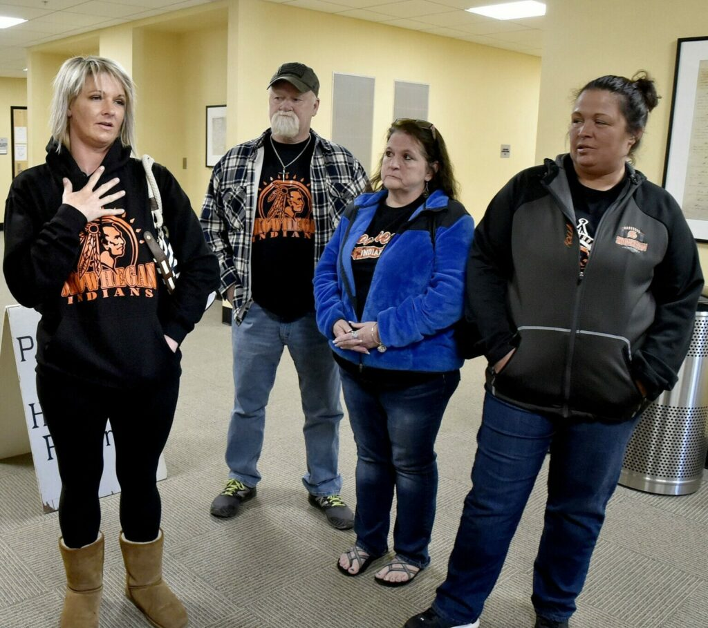 SAD 54 area residents including Michelle Lewis, left, react to a vote to approve a bill to ban the use of Native American mascots in public schools during a hearing in Augusta on Monday. Left to right is Lewis, Larry Hannigan, an unidentified person and Nikki Johnson. The committee voted 7-5 that the bill ought to pass. It is now headed for the House of Representatives.