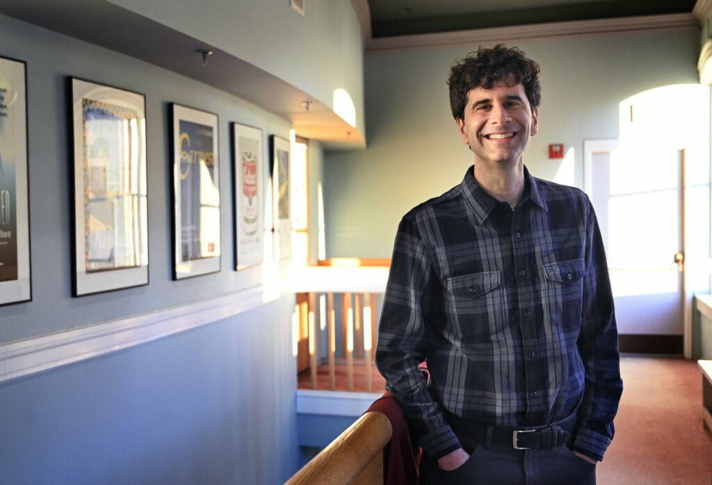 "John Cariani poses at Portland Stage Company Monday. Cariani will return to Maine to act in the play that he wrote, ""Almost, Maine."""