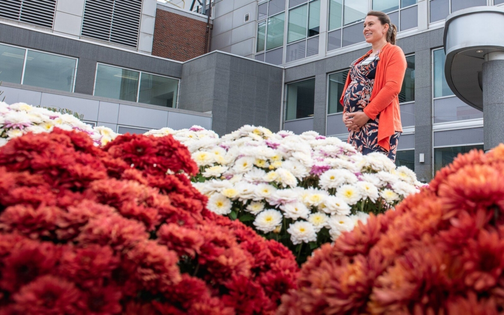 Dr. Rebecca Brakeley, a pediatric hospitalist at Central Maine Medical Center, stands by the entrance of the Lewiston hospital Tuesday afternoon.