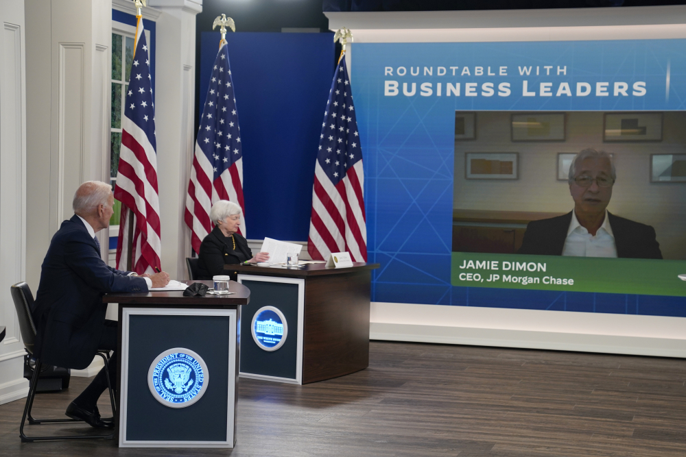 President Biden and Treasury Secretary Janet Yellen listen as Jamie Dimon, CEO of JP Morgan Chase, speaks during a meeting with business leaders about the debt limit on the White House campus on Wednesday in Washington.