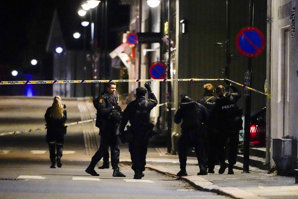 Police stand at the scene after an attack in Kongsberg, Norway, on Wednesday.