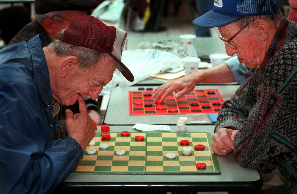Saturday, November 23, 1996 -- Nate Cohen and Rodney Scoville ponder their next moves as the two concentrate on their quiet game in the midst of shopper activity at the Maine Mall.
