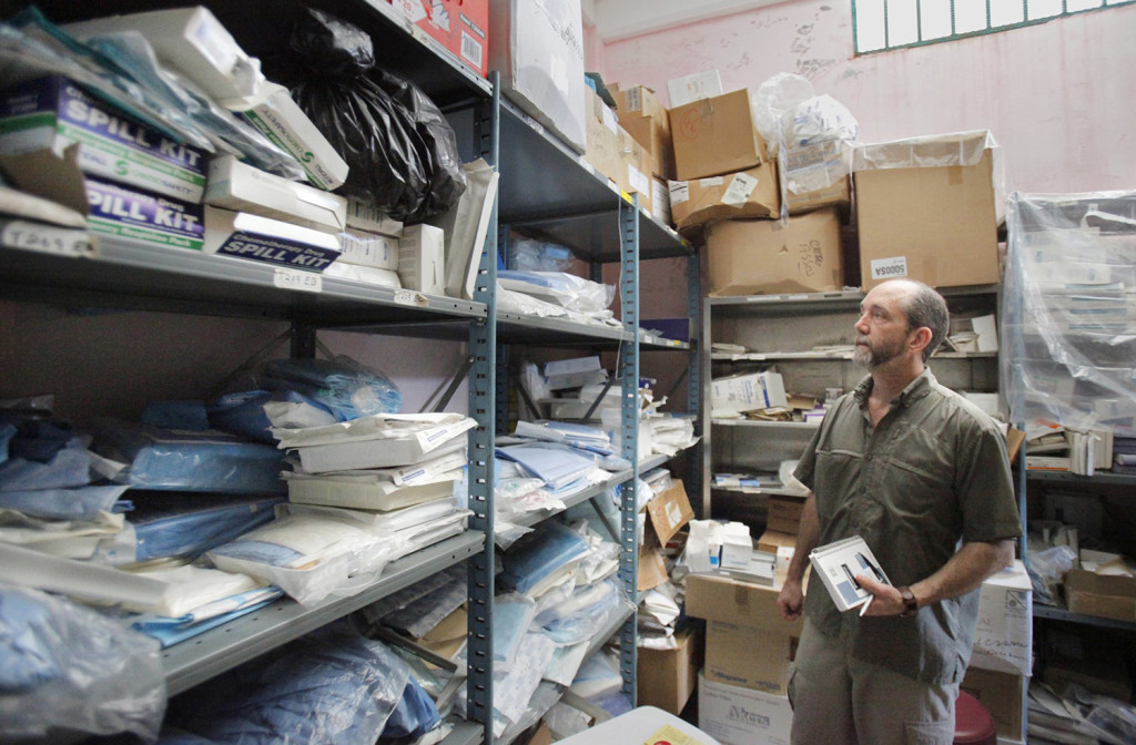 Nate Nickerson, executive director of Konbit Sante, looks over medical supplies in a store room at the Justinian Hospital on Tuesday, January 19, 2010. The store room for the supplies and staff to inventory the supplies that are donated is one way Konbit Sante provides ongoing support to the Justinian Hospital.