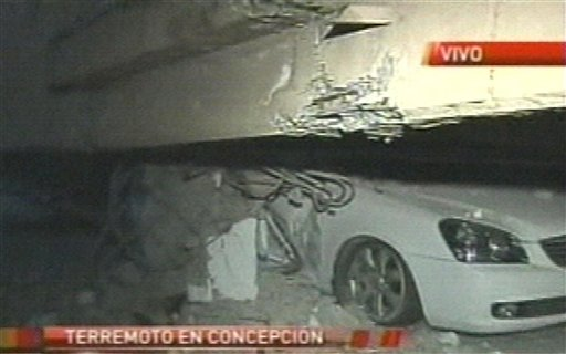 In this image provided by TVN a crushed car can be seen in a parking garage in Concepcion, Chile, following the earthquake early this morning.