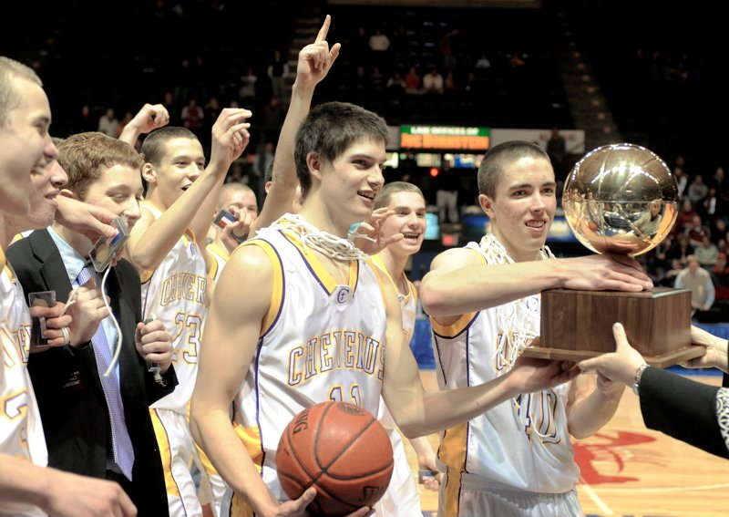 Indiana Faithfull, left, and Kyle Randall of Cheverus receive the Gold Ball after the Stags defeated Edward Little 55-50 in the Class A state final at the Cumberland County Civic Center.
