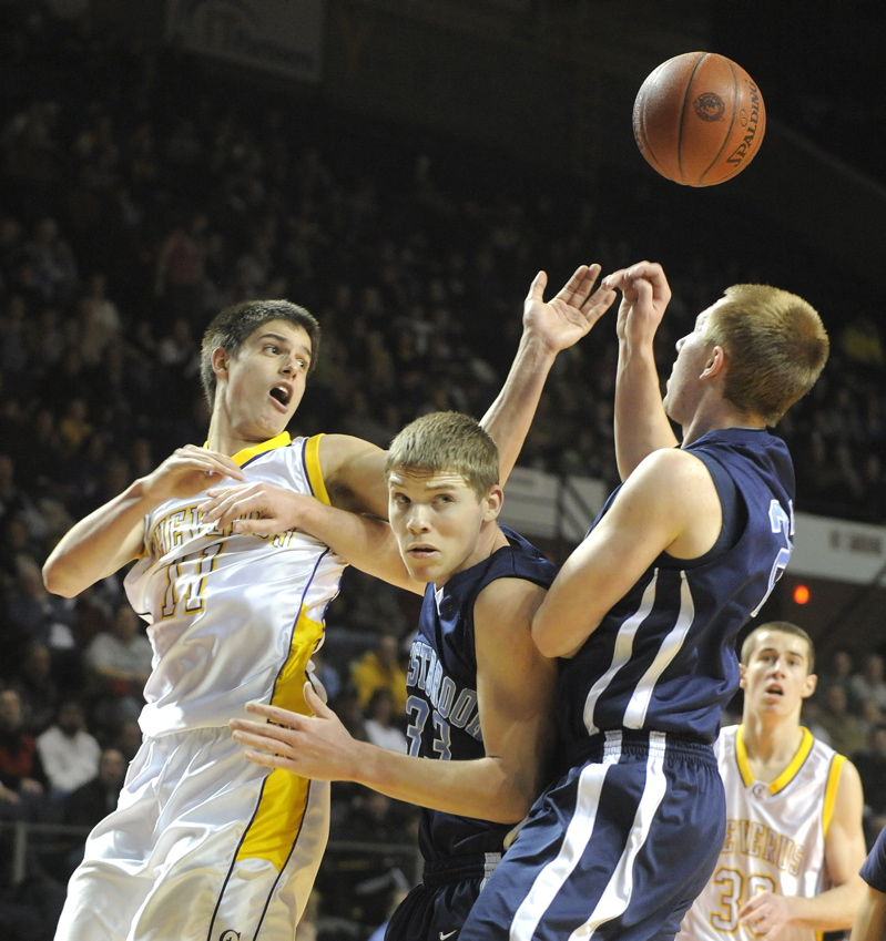 Indiana Faithfull, left, of Cheverus and Andrew Beckwith, right, of Westbrook have their eyes on a loose ball.