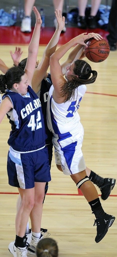 Madison's Andrea Smith gets fouled while trying to shoot over Calais defenders Brook Young, left, and Nicole Osborne.