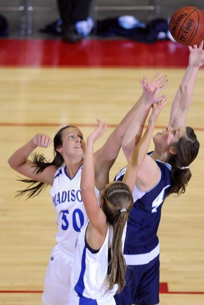 Andrea Smith, left, and Alexandra Russell of Madison battle for a rebound with Nicole Osborne.