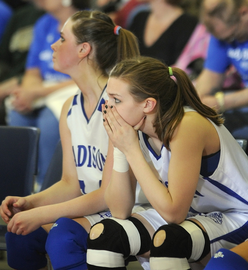 Madison's Jennifer Brown, left, and Kirsta Grant watch from the bench as time runs out on their team in the Class C girls' basketball state championship game against Calais.