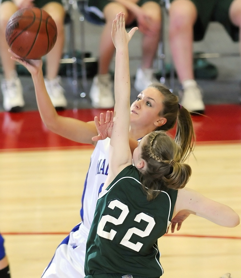 Ali Russell goes up for a shot against Catherine Veroneau.