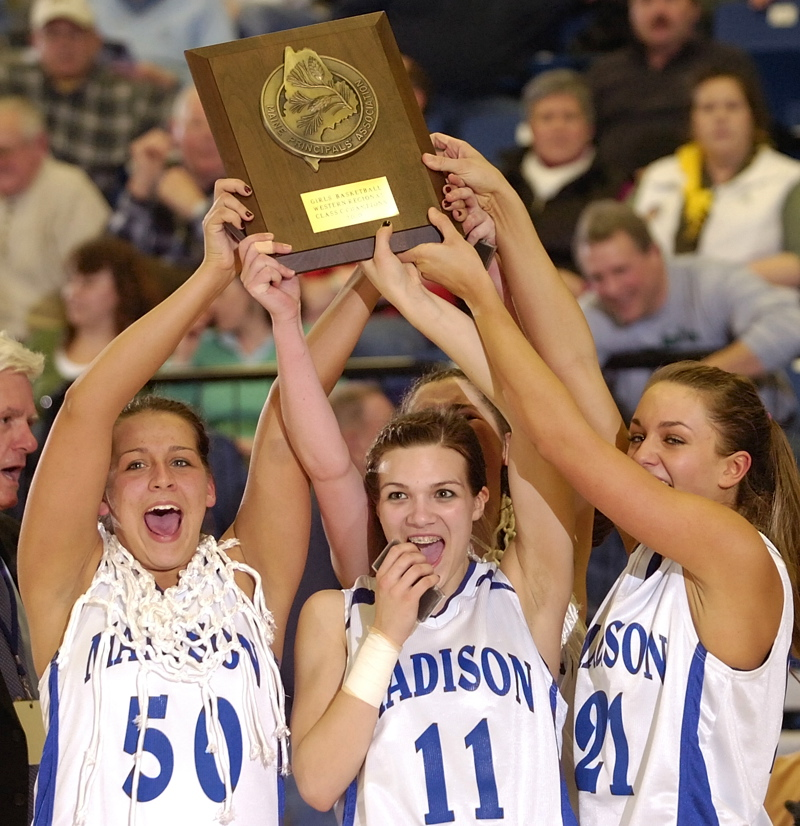 Andrea Smith, left, Marlisa Emerson and Alexandra Russell hold up the championship plaque after Madison beat Waynflete 37-23 in the Western Class C final at the Augusta Civic Center.