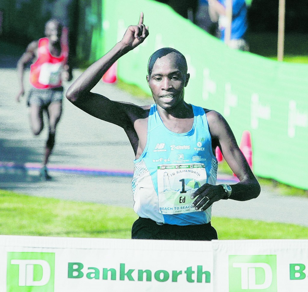 Ed Muge, 26, of Kenya is first across the finish line in the 2009 Beach to Beacon 10K race. One participant says a new system for picking entrants is flawed.