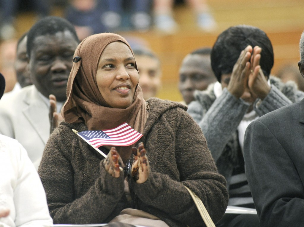 Suad Abrar of Lewiston celebrates her new citizenship Feb. 9 during a ceremony in Falmouth.