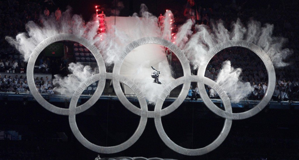 A snowboarder sails through the Olympic rings during the opening ceremony for the Vancouver 2010 Olympics in Vancouver, British Columbia, Friday, Feb. 12, 2010. (AP Photo/Amy Sancetta)