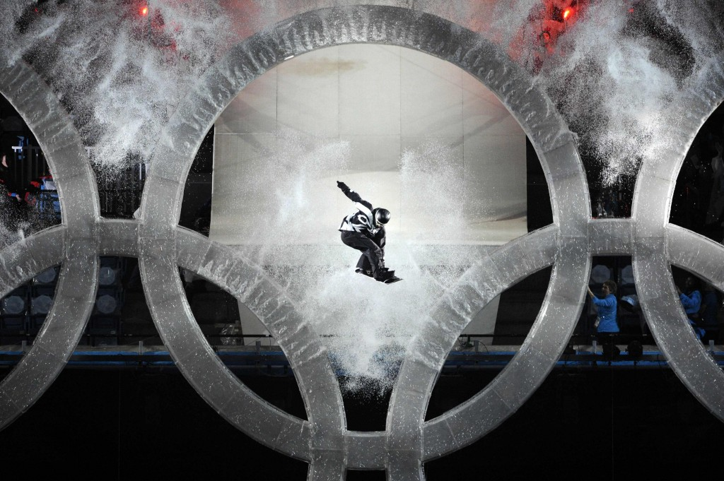 A snowboarder jumps through the Olympic rings during the opening ceremony for the Vancouver 2010 Olympics in Vancouver, British Columbia, Friday, Feb. 12, 2010. (AP Photo/Mark J. Terrill)