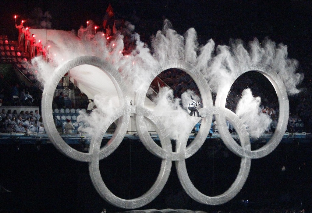 A snowboarder sails through the Olympic rings during the opening ceremony for the Vancouver 2010 Olympics in Vancouver, British Columbia, Friday, Feb. 12, 2010. (AP Photo/Charlie Riedel)