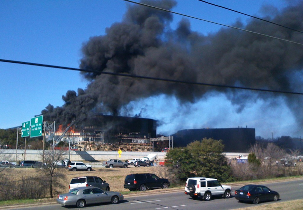Smoke billows from a seven-story office building in Austin, Texas, where nearly 200 IRS employees work on Thursday. A small private plane crashed into the building, and the pilot was presumed dead.