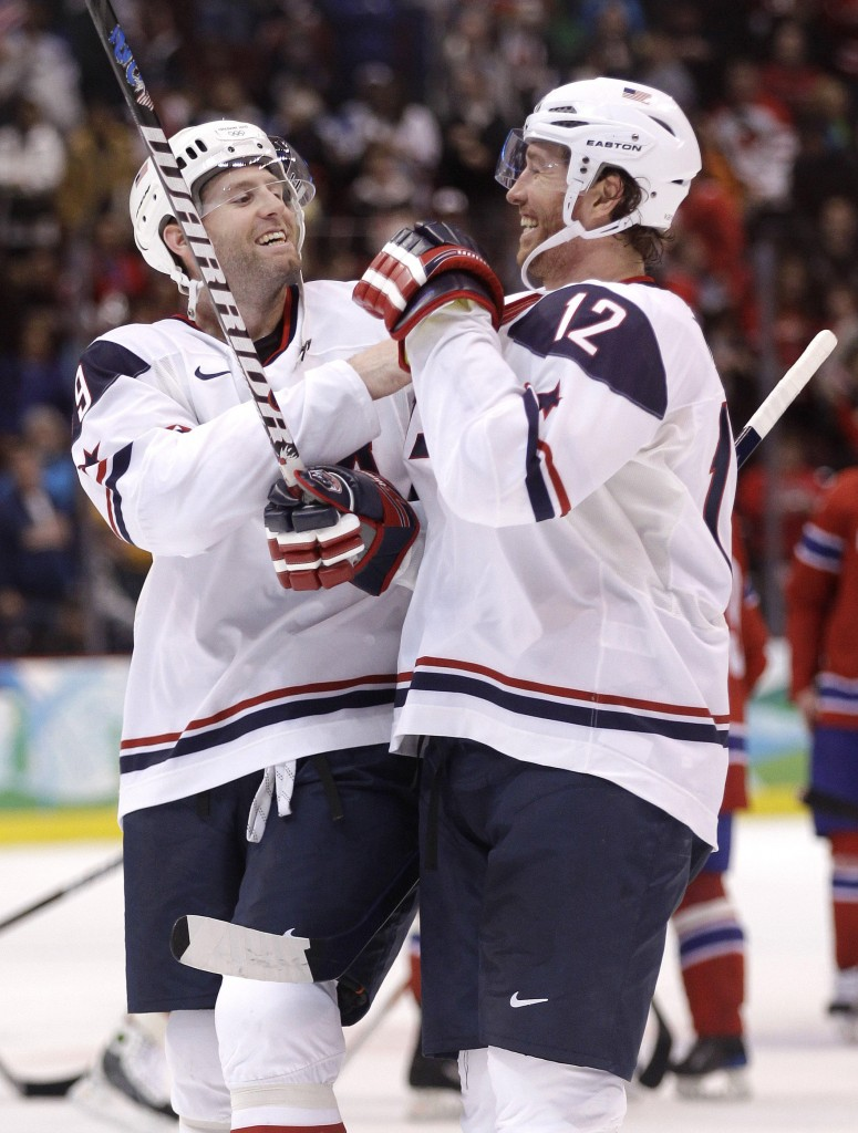 The Associated Press Team USA's Ryan Whitney, left, and Ryan Malone celebrate after beating Norway 6-1 in a prelim.