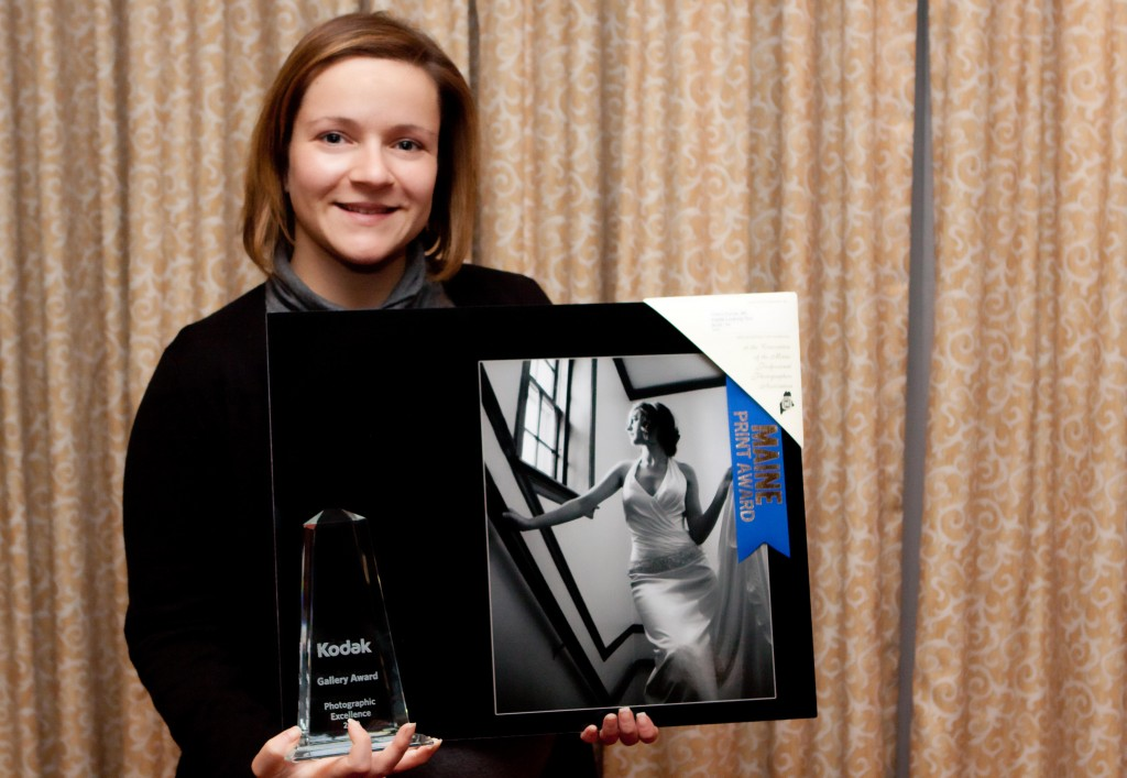 Tiffany Dumas of Georgetown with her Kodak Gallery Award. Dumas is one of five Mainers to win for her work in professional photography.