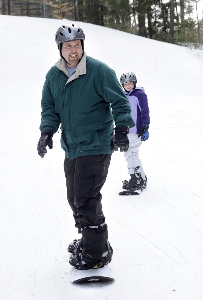 "Drew Sachs and daughter Deidre try boarding. Sachs says he and his wife, Melanie, ""both turned 40 this year and we said, 'This is the year we try new things.' """