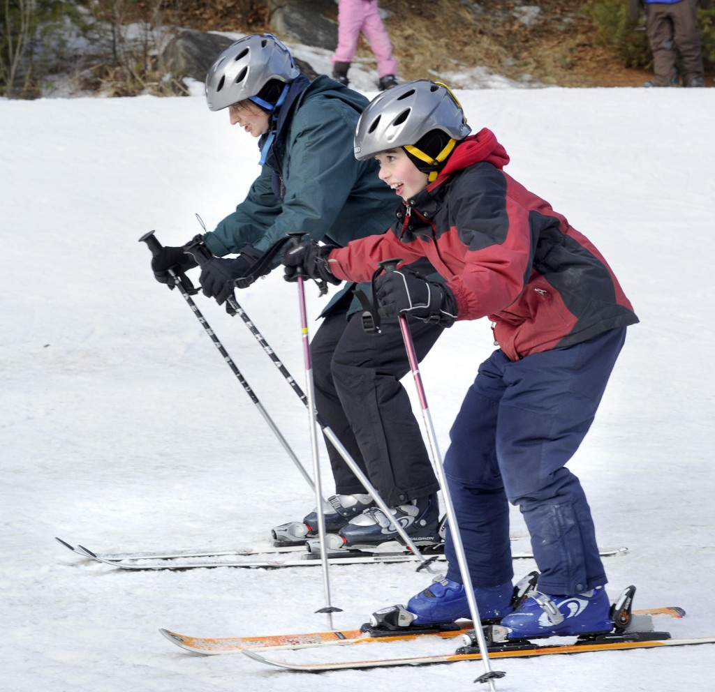 Mom Melanie skis with Peter, 9.