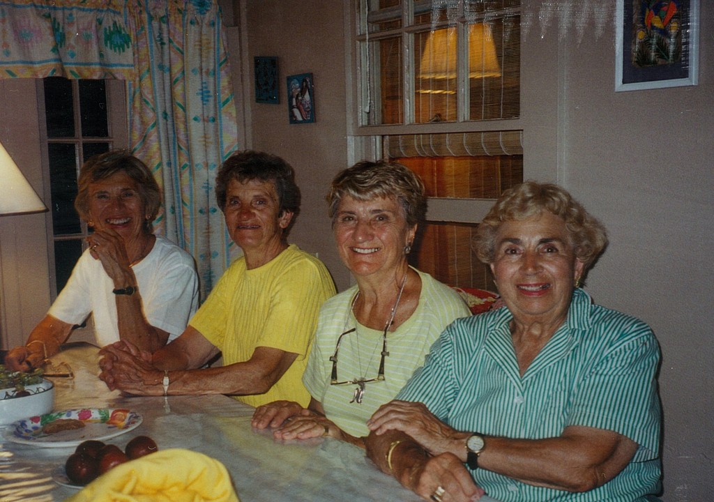 Mildred Doukas, second from left, is shown at the table at the Higgins Beach family cottage in Scarborough. Others from left are her sisters Virginia Doukas, Despina Athans and Stella Doukas.