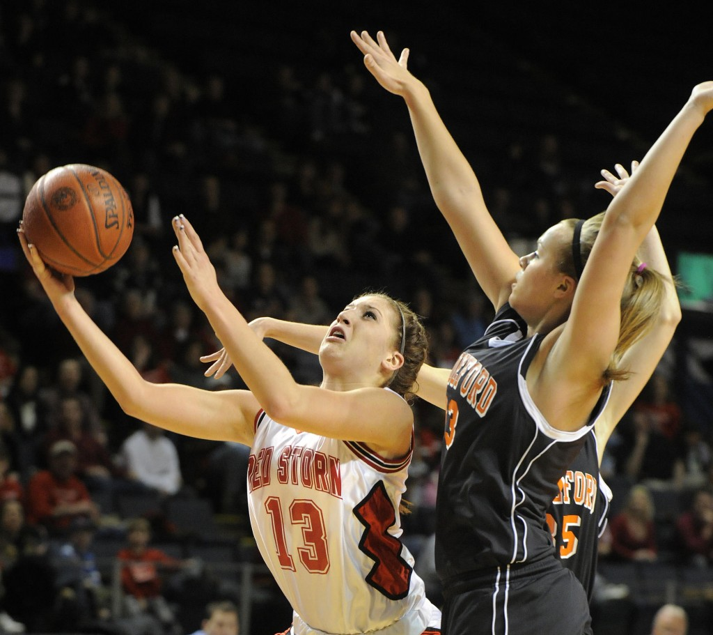 Photo by John Ewing/staff photographer... Friday, February 19, 2010....Scarborough vs. Biddeford girls class A semi-final basketball game. Scarborough's #13, Ellie Morin drives to the basket in front of Biddeford's Keila Grigware.