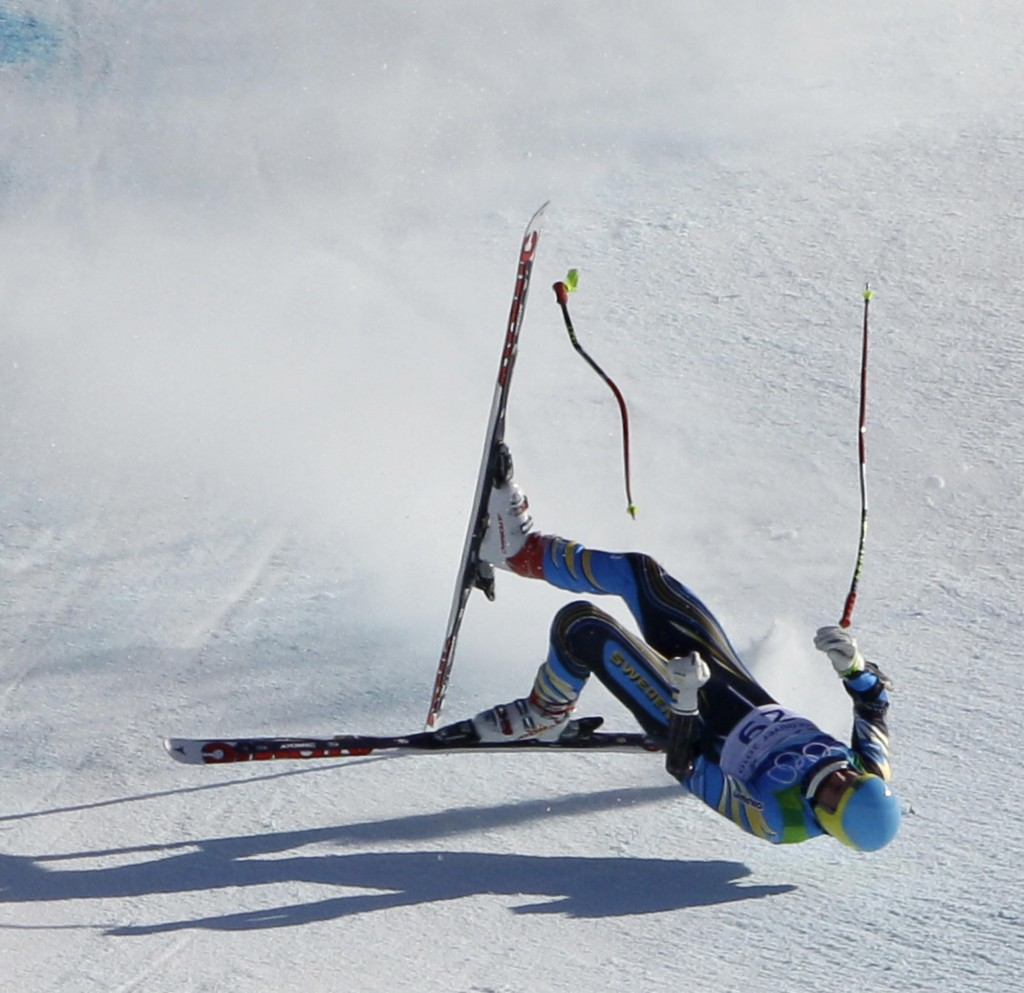 Patrik Jaerbyn, of Sweeden, crashed in the men's super-G event at the Vancouver 2010 Olympics in Whistler, British Columbia, Friday, Feb. 19, 2010. (AP Photo/Charlie Riedel)