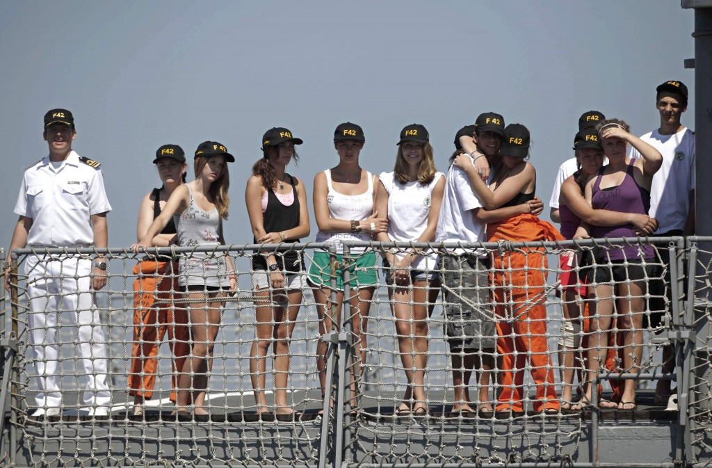 Students from Canada's West Island College arrive at the Mocangue naval base in Rio de Janeiro aboard Brazilian frigate Constituicao on Saturday. They were rescued Thursday after more than a day on life rafts after their ship, Concordia, sank.