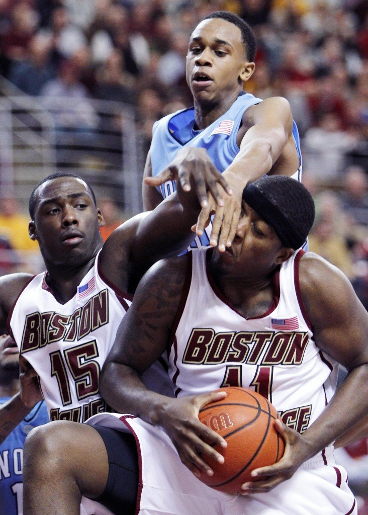 Corey Raji of Boston College gets inside position on North Carolina's John Henson, top, and BC's Rakim Sanders for a rebound. Raji had 16 points to help the Eagles win.