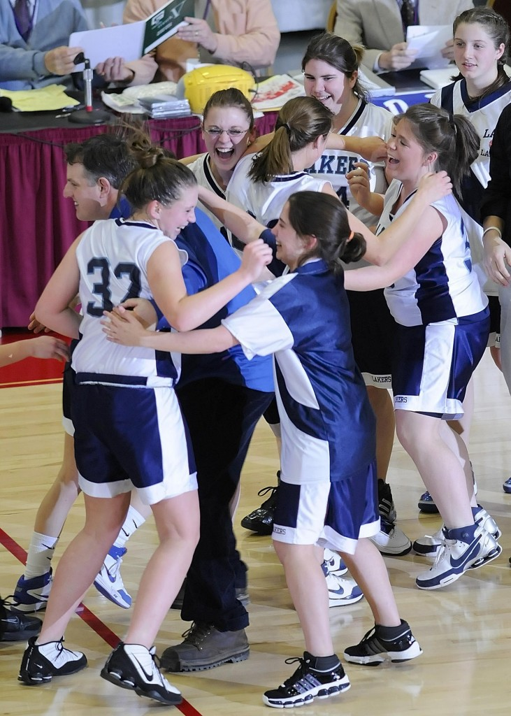 Staff photo by Joe Phelan Greenville Lakers celebrate their 46-29 victory over Rangeley Lakers Saturday in the Western Maine Class D regional game at the Augusta Civic Center.