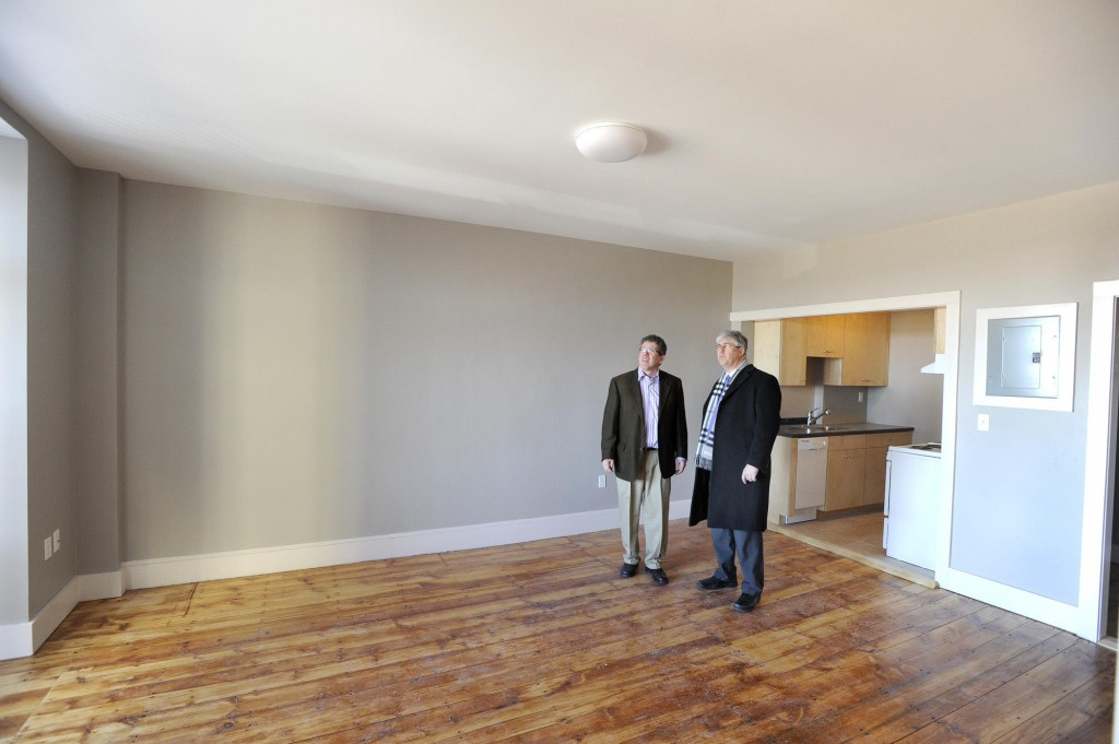 Developer Greg Shinberg, left, shows Portland Mayor Nick Mavodones a new apartment in the renovated former dormitory.